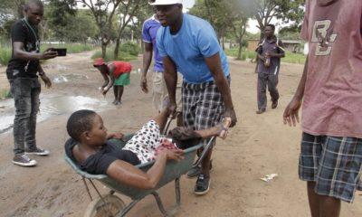 Zimbabwe police fire live rounds